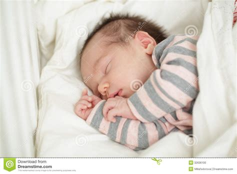 baby sleeping bed sleeping baby in bed up to 20 days stock photo image 32636100
