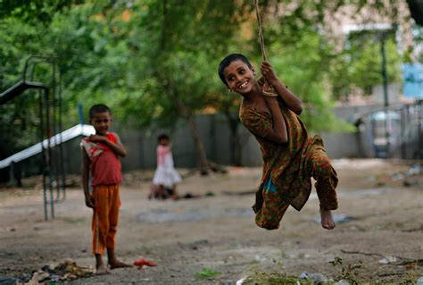 kids swing india image of the day june 11 the new york times