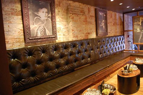 bar banquette seating the venue s victorian themed decor includes burgundy banquette seating large wooden