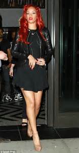 flame haired rihanna paints  town red  night
