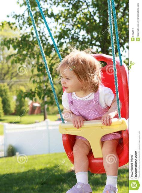 little girl on swing little girl swinging stock images image 5300604