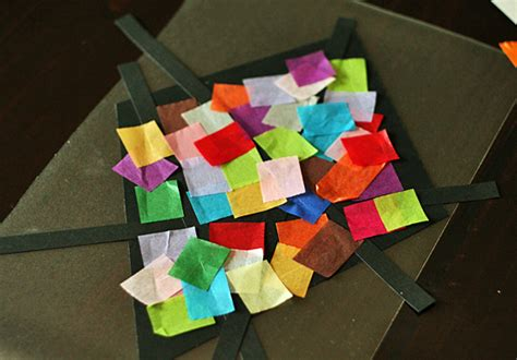 Tissue Paper Stained Glass Craft - colorful stained glass kites window display make and takes