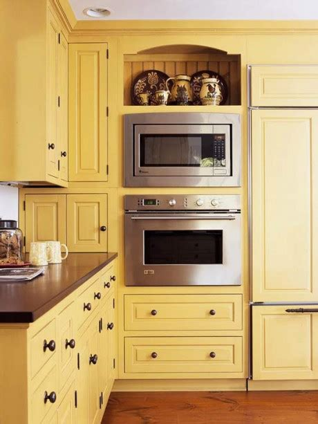yellow painted kitchen cabinets colored kitchen cabinets blogher