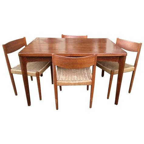 woven dining room chairs modern extendable teak dining table with woven