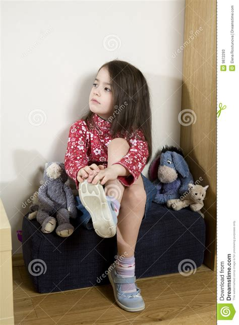 little girl on chair little girl sitting on chair stock photos image 9872293