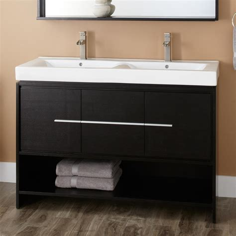 bathroom black bathroom vanity with brown wooden floor