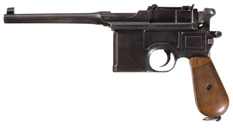 mauser military broomhandle pistol with accessories