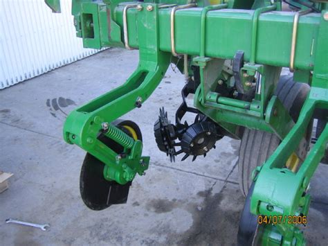viewing a thread fertilizer openers for a jd 1760 planter