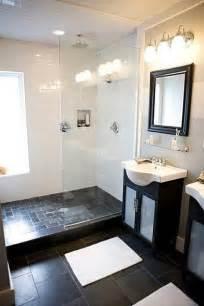 dark floor bathroom small bathroom white subway tile with dark square floor