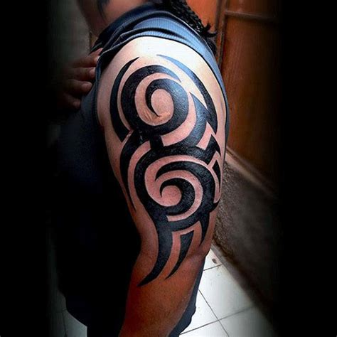 mens tribal tattoos on shoulders and arms 75 tribal arm tattoos for interwoven line design ideas