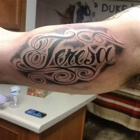 design around name tattoo 40 memorable name tattoos