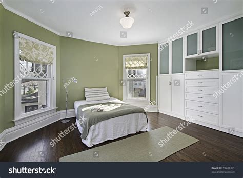 green walls in bedroom master bedroom green walls dark wood stock photo 59744351
