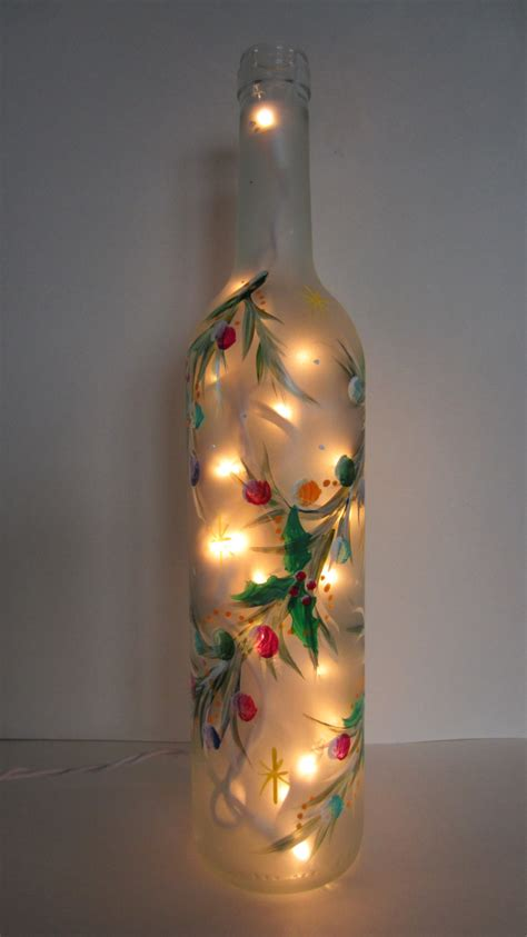 decorative garland covering a frosted lighted bottle