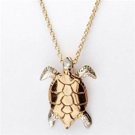 gold and silver turtle pendant by simon kemp jewellers