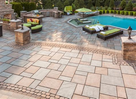 gripping large paver stone patio with resin wicker outdoor