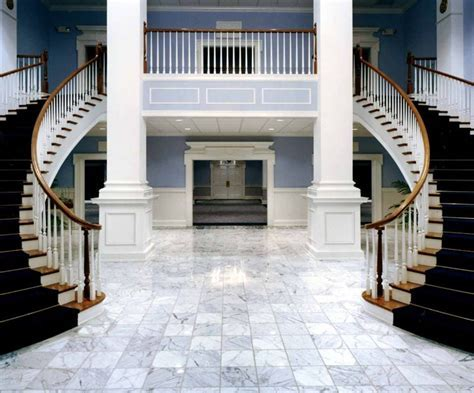 gorgeous double curved staircase. Contact Southern