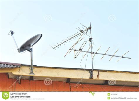 Tv Roof satellite dish and tv antenna at the roof stock image