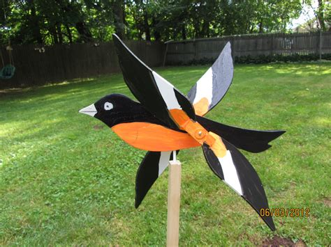 Handmade Yard - handmade wooden oriole bird shaped whirligigs for your yard