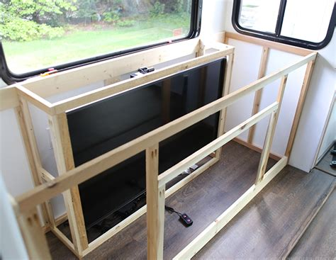 automate around your windows with tv lifts and more nexus 21 installing a tv lift and electric fireplace in rv