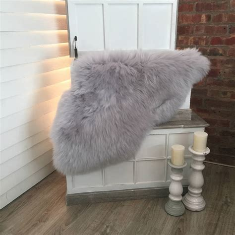 luxury sheepskin rug luxury silver grey sheepskin rugs by cowshed interiors notonthehighstreet
