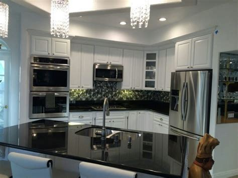 backsplash for black granite and white cabinets black galaxy granite countertops with white cabinets