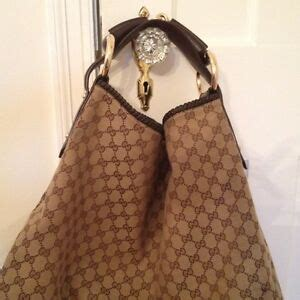gucci brown monogram canvasbrown leather large horsebit