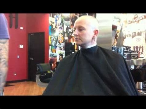 old lady headshave head shave bald women headshave women s head shave in a barbershop with a straight razor