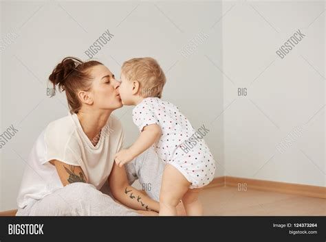 mom son bedroom mother child on white bed mom baby image photo bigstock