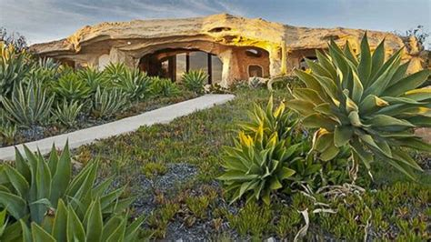 dick clark s flintstone house dick clark s malibu flintstones home has new owner
