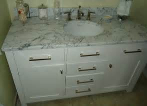file bathroom vanity cabinet including sink and drawers
