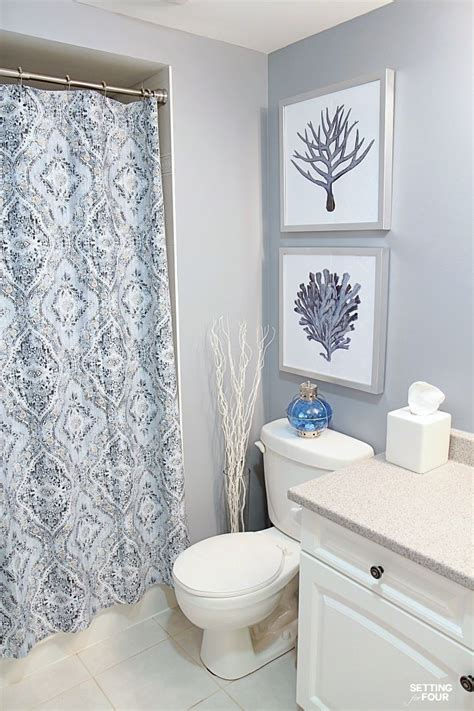hanging pictures in a bathroom height measurements and how to hang pictures in a bathroom