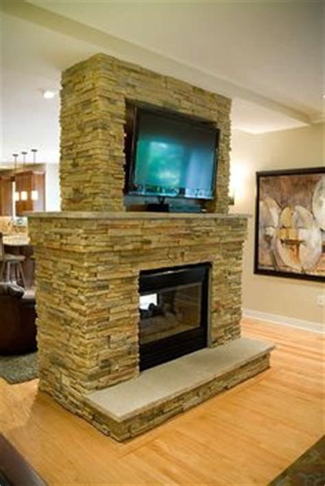 i have always loved a double sided fireplace that is shared with the double sided fireplaces on pinterest stone fireplaces