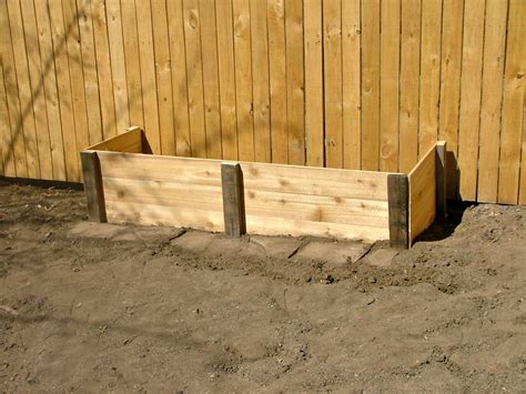 Raised Garden Bed With Fence by Raised Garden Bed Against Fence Garden Post