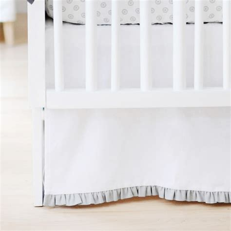 solid white crib skirt with gray ruffle by new arrivals inc