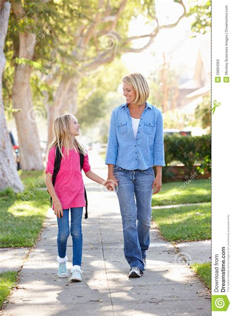 St Momy and walking to school on suburban royalty free stock images image 29684359