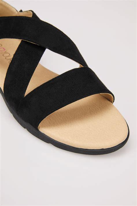 black cross over strap sandals in true eee fit