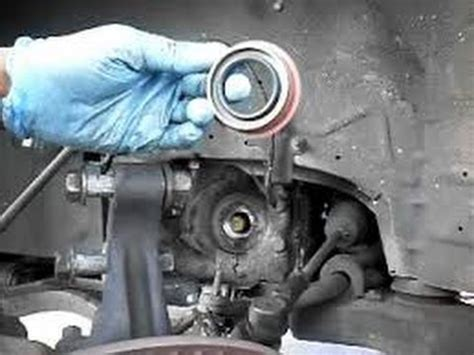 how to replace transmision output/axle shaft seal  gm thm