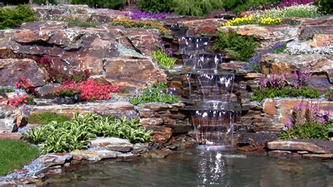 Man Relaxing On Rock Near Waterfall Stock Footage Video Who Made Rock Garden