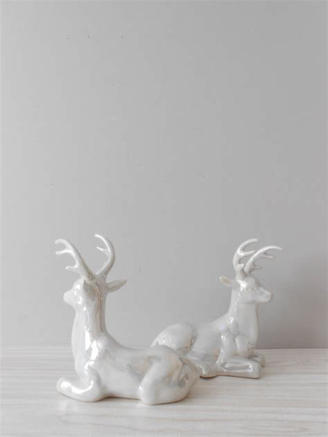 pair of large white ceramic christmas reindeer figurines