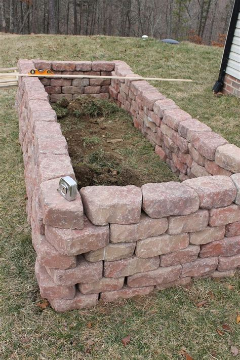 Brick Raised Vegetable Beds Once All Of The Stones Were How To Build A Rock Garden Bed