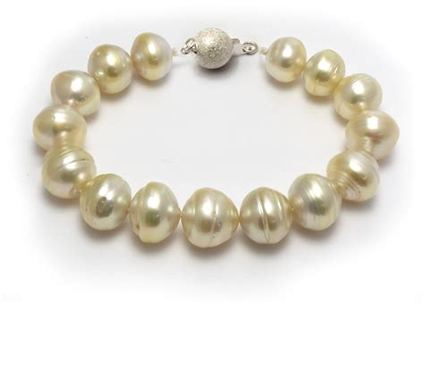 pearls with gold south sea gold pearl bracelet with light golden ringed pearls