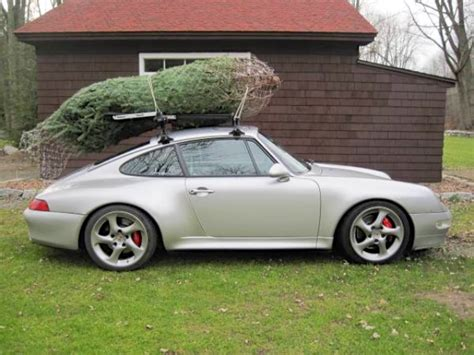 porsche with christmas tree 10 badass cars carrying christmas trees