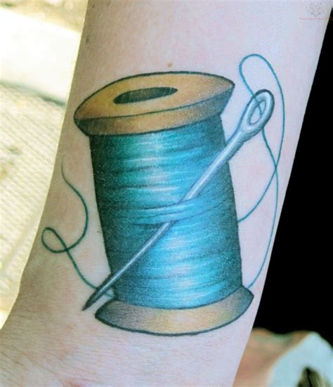 string tattoo designs thread spools blue thread spool and needle