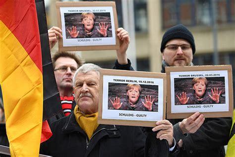 angela merkel protests anger as german chancellor