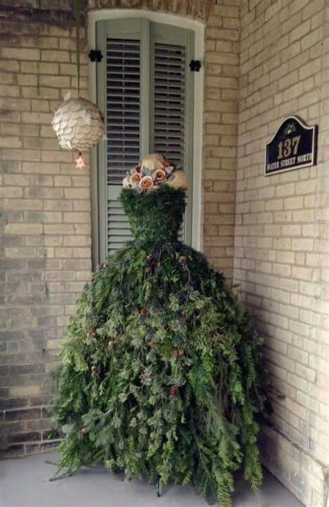 best dressed christmas tree for 1920 house she attaches tree branches to the dress form what it becomes this is stunning