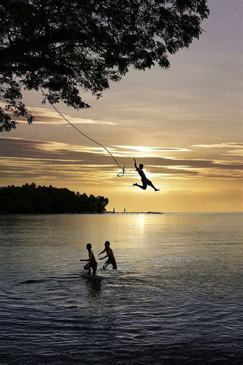 swing over rope swing into the ocean travel bucket list