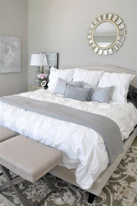 neutral master bedroom white bedding with neutral rug grey accents abstract a interior
