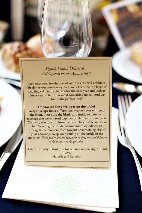 cards & envelopes on each table with the couple's