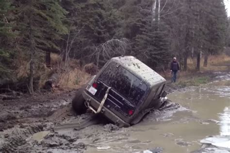jeep mudding gone wrong video jeep gets stuck in mud has no option but to go for