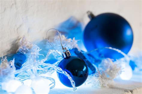 blue  silver xmas ornaments  bright holiday background  space  text merry christmas